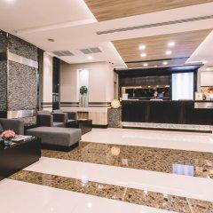 Отель Adelphi Suites Bangkok интерьер отеля