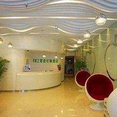 Отель Apple Designer Hotel Китай, Сиань - отзывы, цены и фото номеров - забронировать отель Apple Designer Hotel онлайн интерьер отеля