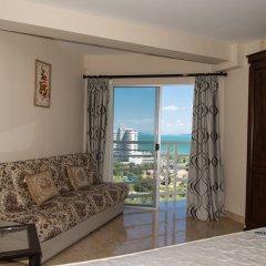 Отель Jomtien Beach Condominium Паттайя комната для гостей