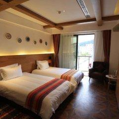 Отель Aizhu Boutique Theme Hotel Китай, Сямынь - отзывы, цены и фото номеров - забронировать отель Aizhu Boutique Theme Hotel онлайн комната для гостей