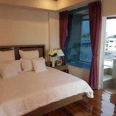 Отель S.E.T Thanmongkol Residence Бангкок комната для гостей фото 3