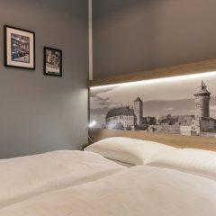 Отель dasPaul Aparthotel Германия, Нюрнберг - отзывы, цены и фото номеров - забронировать отель dasPaul Aparthotel онлайн комната для гостей фото 2