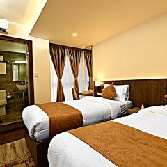 Отель The Milestone Hotel Непал, Катманду - отзывы, цены и фото номеров - забронировать отель The Milestone Hotel онлайн комната для гостей фото 4