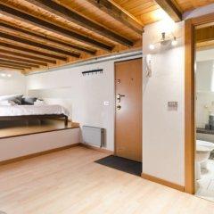 Отель Cadorna Suites сейф в номере