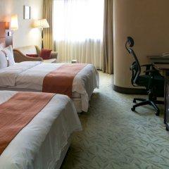 Отель Holiday Inn Shenzhen Donghua Китай, Шэньчжэнь - отзывы, цены и фото номеров - забронировать отель Holiday Inn Shenzhen Donghua онлайн фитнесс-зал фото 2