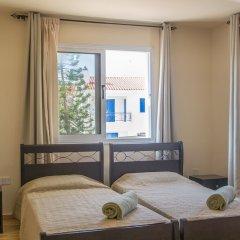 Отель Konnos 2 Bedroom Apartment Кипр, Протарас - отзывы, цены и фото номеров - забронировать отель Konnos 2 Bedroom Apartment онлайн комната для гостей фото 4