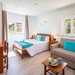 Отель Flôr da Laranja, Albufeira Португалия, Албуфейра - отзывы, цены и фото номеров - забронировать отель Flôr da Laranja, Albufeira онлайн комната для гостей