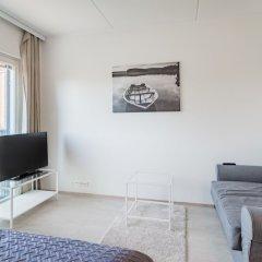 Апартаменты Local Nordic Apartments - Snowy Owl Ювяскюля комната для гостей фото 2