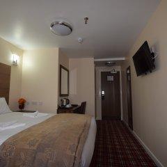 Отель Lucky 8 Лондон комната для гостей