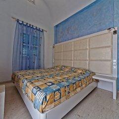Отель Sellada Apartments Греция, Остров Санторини - отзывы, цены и фото номеров - забронировать отель Sellada Apartments онлайн комната для гостей фото 5