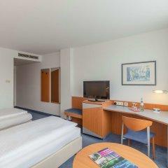 Отель Ramada by Wyndham Hannover Германия, Ганновер - отзывы, цены и фото номеров - забронировать отель Ramada by Wyndham Hannover онлайн удобства в номере фото 2
