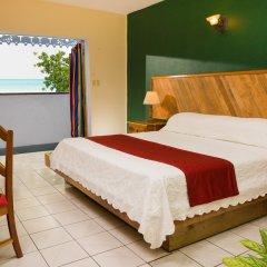 Отель Legends Beach Resort Ямайка, Негрил - отзывы, цены и фото номеров - забронировать отель Legends Beach Resort онлайн комната для гостей фото 4