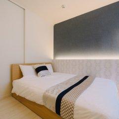 Отель GRAND BASE Hakata Haruyoshi Япония, Фукуока - отзывы, цены и фото номеров - забронировать отель GRAND BASE Hakata Haruyoshi онлайн комната для гостей фото 4