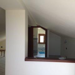 Отель Villa La Scogliera Фонтане-Бьянке сейф в номере