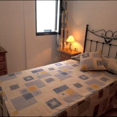 Апартаменты Cala Apartments 3Pax Bajo A Гинигинамар комната для гостей фото 2