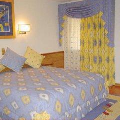 Отель Alif Campo Pequeno Лиссабон комната для гостей