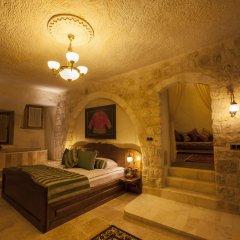 Отель Kayakapi Premium Caves Cappadocia комната для гостей