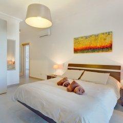 Отель Stunning Seafront Lux Apt, Fort Cambridge wt Pool Мальта, Слима - отзывы, цены и фото номеров - забронировать отель Stunning Seafront Lux Apt, Fort Cambridge wt Pool онлайн комната для гостей фото 3
