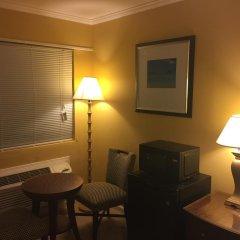 Отель Dragon Inn & Suites удобства в номере