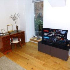 Апартаменты Blauhouse Apartments Вена комната для гостей фото 2