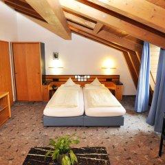 Отель Villa Waldperlach Германия, Мюнхен - отзывы, цены и фото номеров - забронировать отель Villa Waldperlach онлайн комната для гостей фото 2
