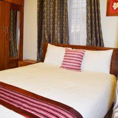 Апартаменты Al-Minhaj Service Apartments комната для гостей фото 4