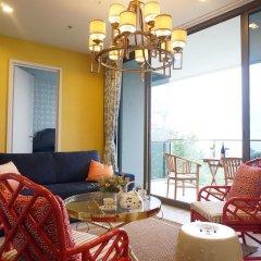 Отель Baan Plai Haad Beachfront Condominium Паттайя комната для гостей фото 2