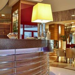 Отель UNAHOTELS Expo Fiera Milano Италия, Милан - отзывы, цены и фото номеров - забронировать отель UNAHOTELS Expo Fiera Milano онлайн интерьер отеля