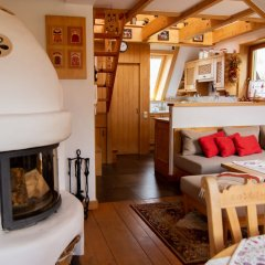Отель InspiroApart Giewont Lux - Sauna i Basen Косцелиско комната для гостей
