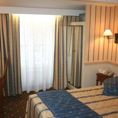 Отель POUSSIN Париж удобства в номере фото 2