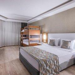 Отель Palm Wings Ephesus Beach Resort Торбали комната для гостей фото 5