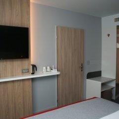 Отель Holiday Inn Express Zurich Airport Швейцария, Рюмланг - 1 отзыв об отеле, цены и фото номеров - забронировать отель Holiday Inn Express Zurich Airport онлайн удобства в номере фото 2