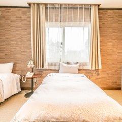 Petit Hotel Enchante Хакуба комната для гостей фото 3