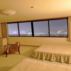 Отель Enjoy The Night View Of Nagasaki And Shippoku Cuisine | Nissho Cans New Wing Baishokaku Нагасаки комната для гостей фото 2