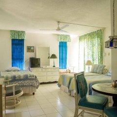 Отель Sky View Beach Studio - Montego Bay Club Ямайка, Монтего-Бей - отзывы, цены и фото номеров - забронировать отель Sky View Beach Studio - Montego Bay Club онлайн комната для гостей