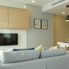 Отель Cetus Beachfront Condo By Pong Паттайя комната для гостей
