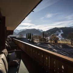 Отель HUUS Gstaad Швейцария, Занен - отзывы, цены и фото номеров - забронировать отель HUUS Gstaad онлайн балкон