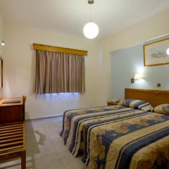 Отель Kefalos Damon Hotel Apartments Кипр, Пафос - отзывы, цены и фото номеров - забронировать отель Kefalos Damon Hotel Apartments онлайн комната для гостей фото 3
