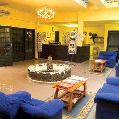 Отель Puerto Caleta интерьер отеля фото 3