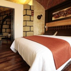 Aztic Hotel & Suites Ejecutivas комната для гостей фото 3