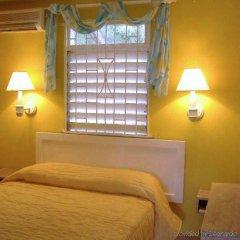Отель Sunflower Cottages and Villas Ямайка, Ранавей-Бей - отзывы, цены и фото номеров - забронировать отель Sunflower Cottages and Villas онлайн комната для гостей фото 3