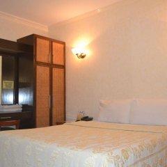 Отель Bliss Hotel Dau Филиппины, Мабалакат - отзывы, цены и фото номеров - забронировать отель Bliss Hotel Dau онлайн комната для гостей фото 3