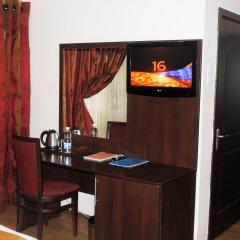 Отель Grand Inn & Suites удобства в номере