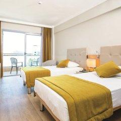 Sunrise Hotel комната для гостей