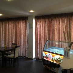 TM Deluxe Hotel комната для гостей
