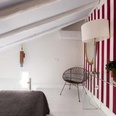 Отель Apartamentos Casa Malasaña Испания, Мадрид - отзывы, цены и фото номеров - забронировать отель Apartamentos Casa Malasaña онлайн интерьер отеля