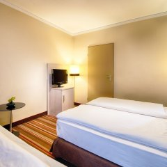 Leonardo Hotel & Residenz München комната для гостей фото 7