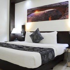 Отель Executive Plaza Hotel Филиппины, Манила - отзывы, цены и фото номеров - забронировать отель Executive Plaza Hotel онлайн комната для гостей фото 2