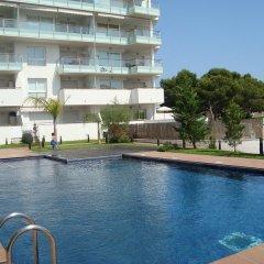 Отель Aquamarina - One Bedroom бассейн