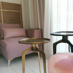 Отель Serenity Suites удобства в номере